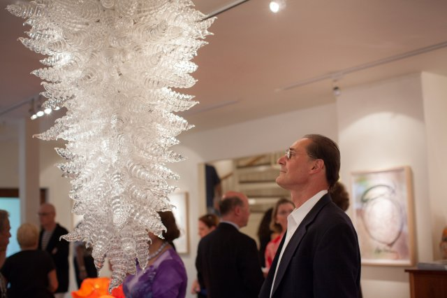 Jim Schantz admires the Clear Platinum Hornet Chandelier, 2016, 53 x 36 x 36""